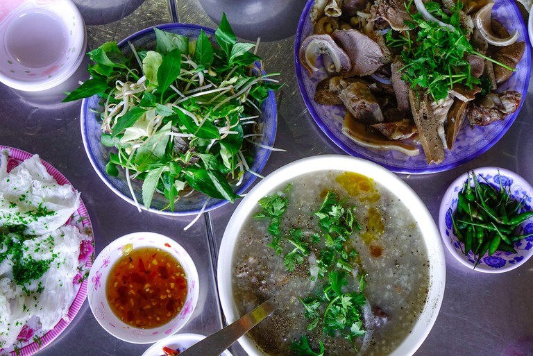 Rice porridge with pork and boiled pig guts for breakfast in Quy Nhon, Vietnam.