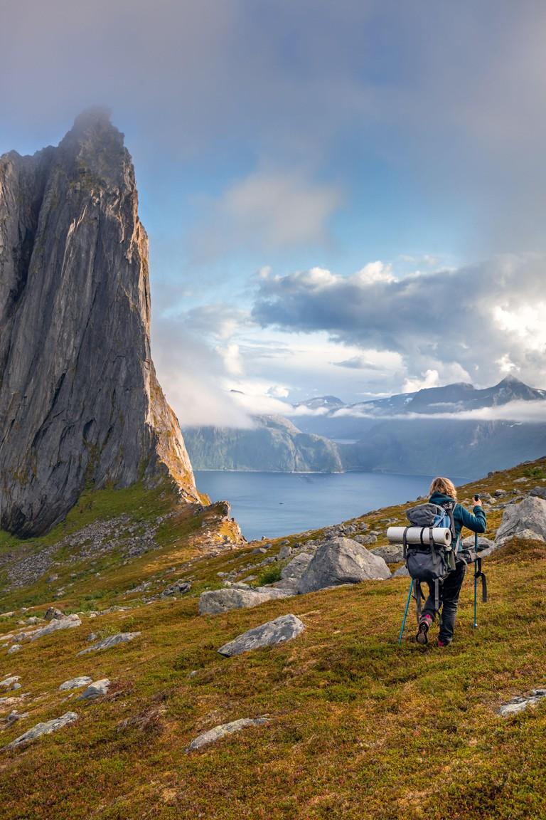 Backpacker exploring Segla Mountain