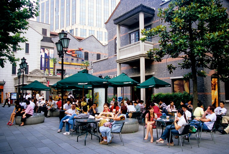 Shanghai China upscale Xintiandi New Heaven and Earth Restaurant Mall with customers of Starbucks Coffee