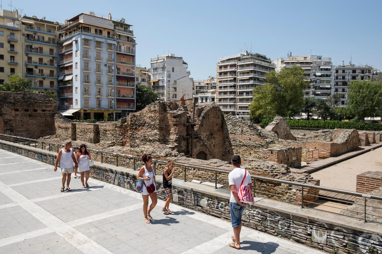 Tourists at Navarinou square in Thessaloniki, Greece on August 2014.