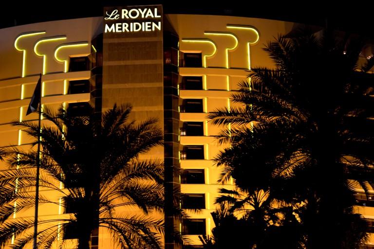 Exterior of Le Royal Meridien hotel in Dubai at night.