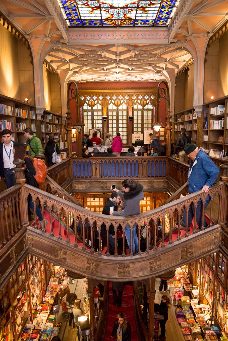 Tourists inside the lello library,Along with Bertrand in Lisbon, it is one of the oldest bookstores in Portugal.