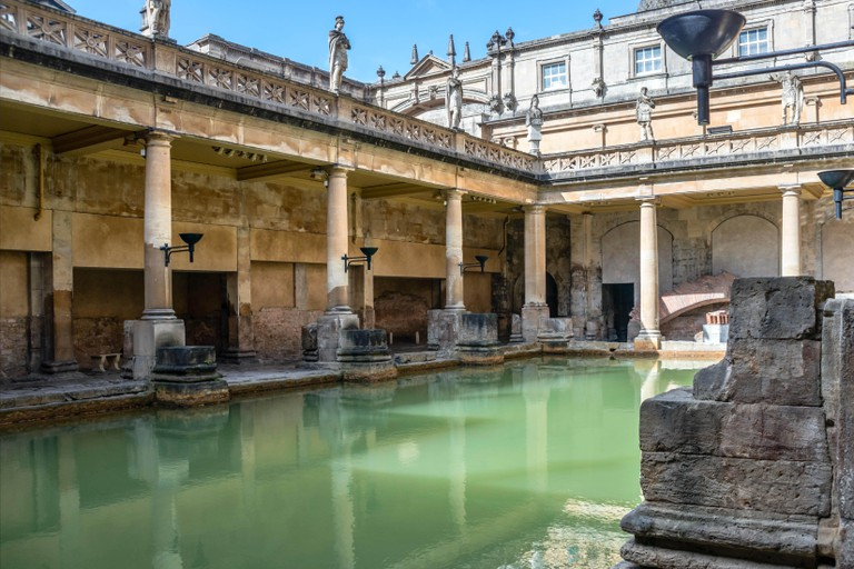 The Great Bath of the Roman Baths complex, a site of historical interest in the English city of Bath, Somerset, England.