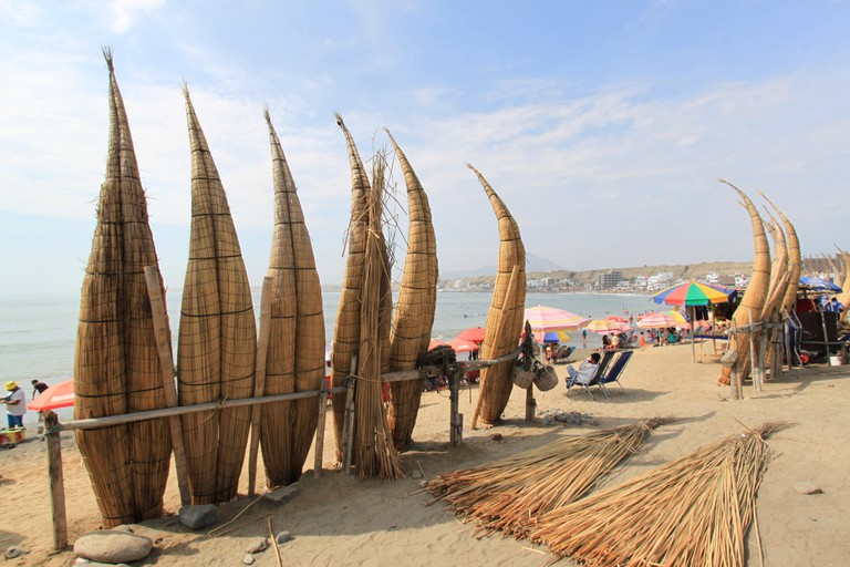 'Caballitos de Totora', traditional fishing boats made of reeds, on the beach in Huanchaco, Peru.