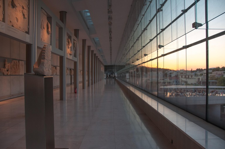 Acropolis Museum at sunset overlooking Acropolis Hill in Athens, Greece