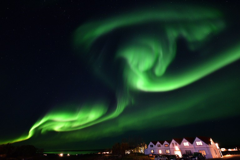 Aurora borealis, also known as northern lights, illuminates the sky in Iceland.