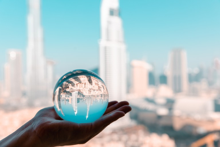 Crystal Ball with Reflection of Dubai CBD Skyline