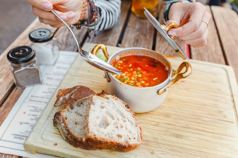 Traditional Hungarian goulash soup with a beautiful serving. The concept of local cuisine in Budapest