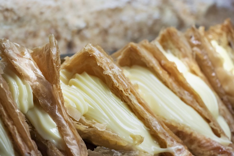 Closeup of Trigona Panoramatos, a traditional greek dessert filled with cream.