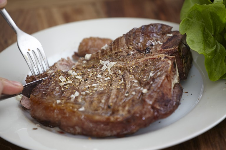 Large steak on plate