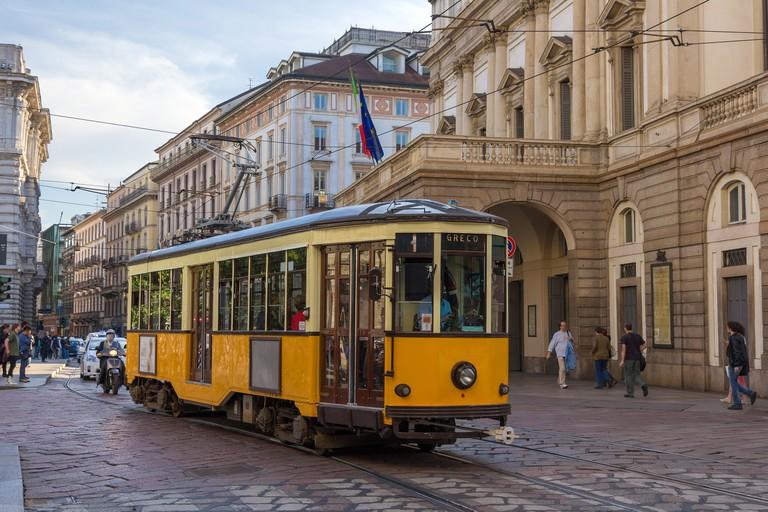 Old tram passing at La Scala theatre in Milan