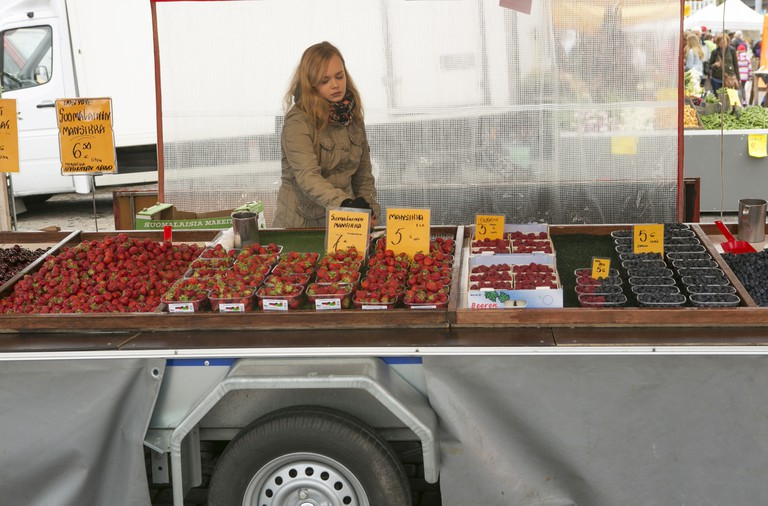 person selling fresh fruit by market square at helsinki finland