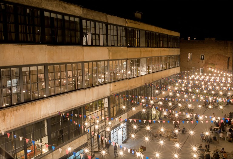 Modern design courtyard of urban art area Fabrika with youth party inside