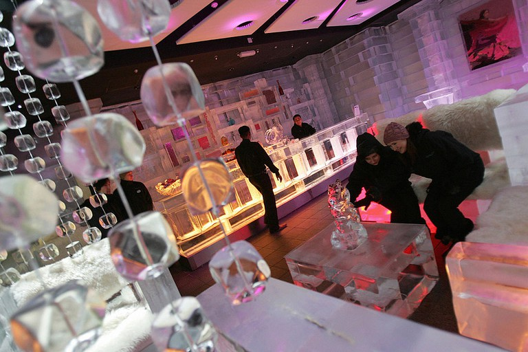 Guests inspect an ice sculpture decorati