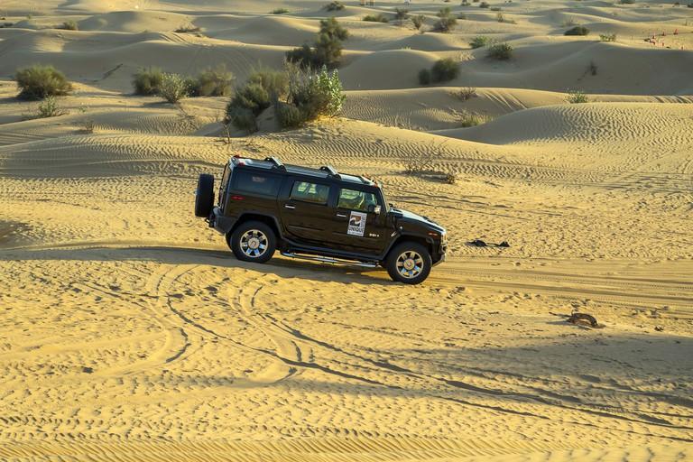 Driving on jeeps Desert Safari Hummer H2