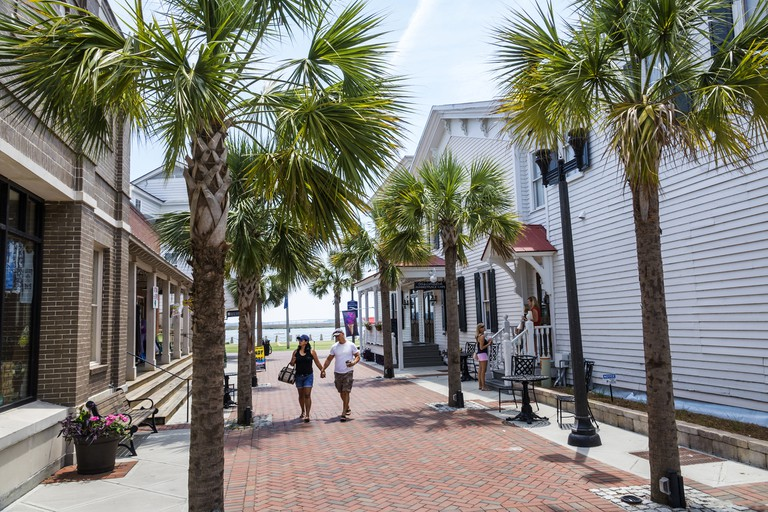South Carolina, Beaufort, Bay Street, Historic Downtown, waterfront shops with couple walking