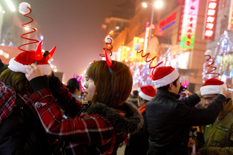 dressed up Chinese Christmas revellers h