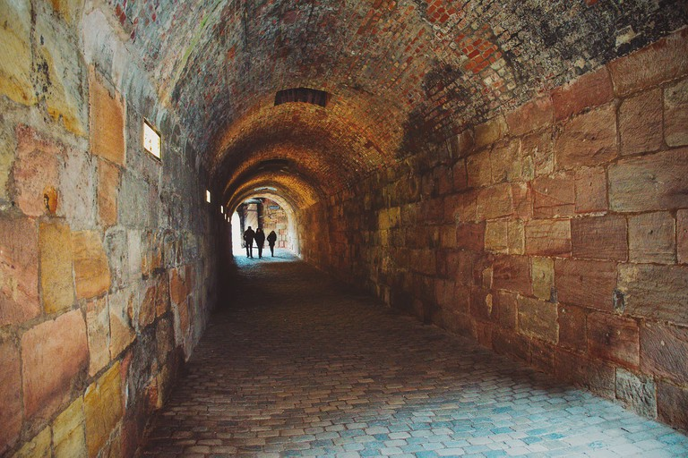 Silhouette People Walking in Tunnel at Nuremberg City, Germany