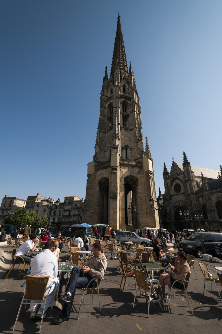 France, Bordeaux, Basillica Saint Michel, belltower and outdoor cafe seating