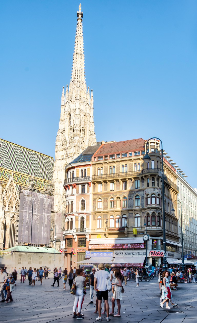 VIENNA, AUSTRIA - AUGUST 30: People in the pedestrian area at St. Stephen's Cathedral in Vienna, Austria on August 30, 2017.