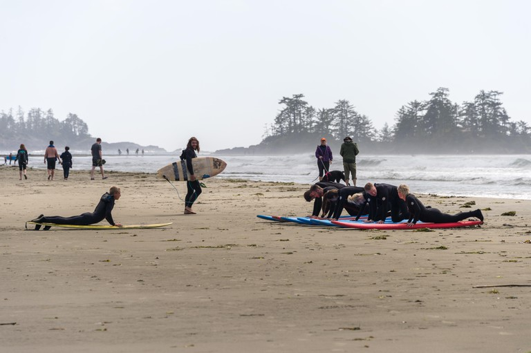 A surfing class on Chesterman beach in Tofino