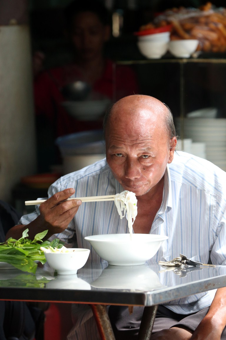Man eating Vietnamese pho