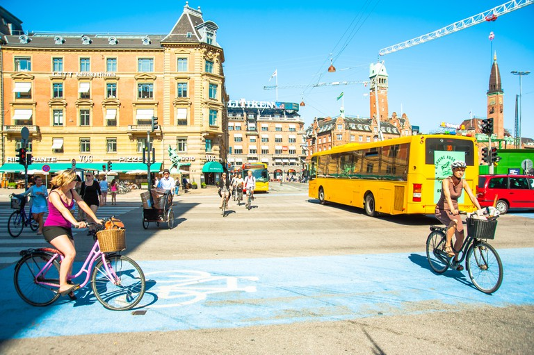 Cycling in Copenhagen, Denmark Europe all types of cyclists, cycle and commute during rush hour traffic with ease in the Danish Capital Kobenhaven.
