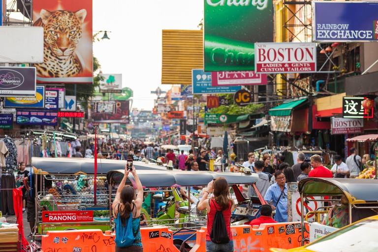 BANGKOK, MAY 11: Tourists take photos on Bangkok's Khao San Road on March 11.