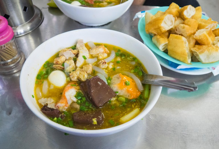 Bowls of banh canh cua, a crab noodle soup