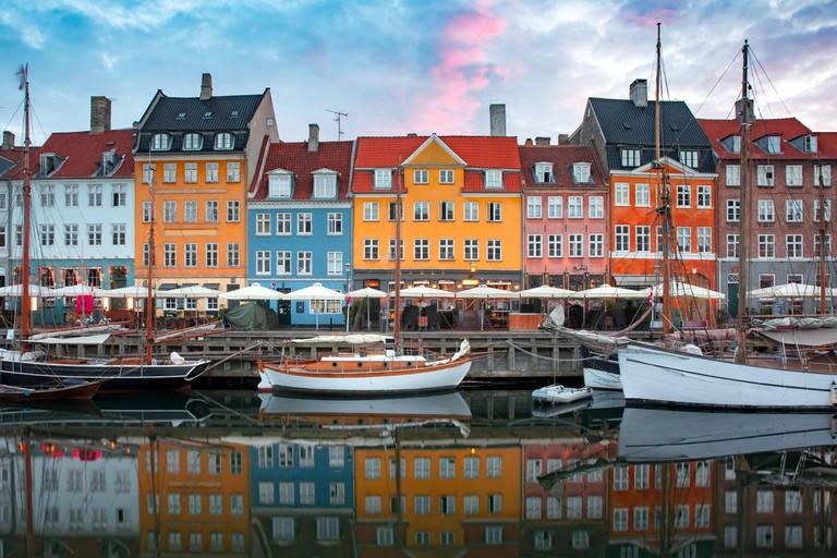 Nyhavn at sunrise in Copenhagen, Denmark.
