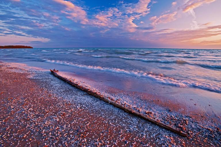 Pebbles and shells on Lake Ontario shoreline of Sandbanks Provincial Park