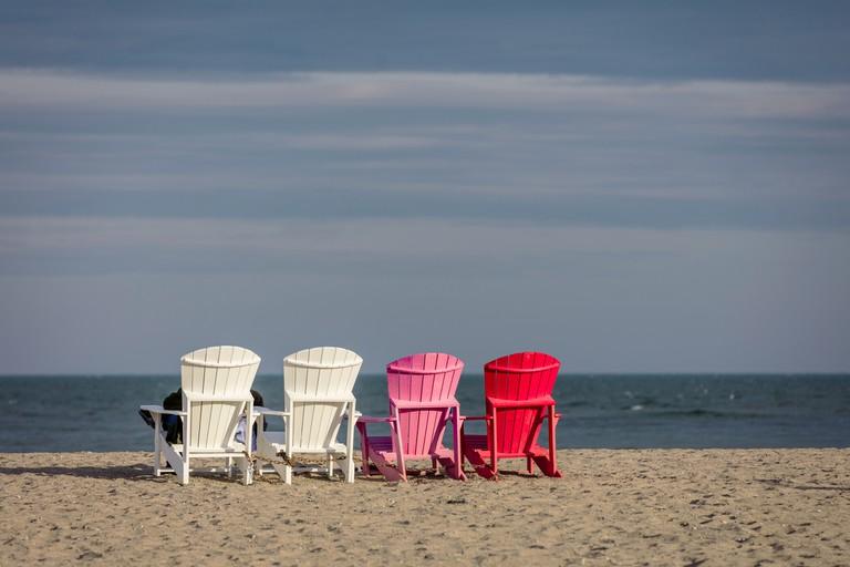 Adirondack chairs in the sun on Woodbine beach