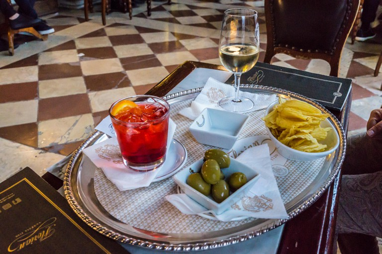 Aperol spritz and white wine with snacks at Caffe Florian, St. Mark's Square, Venice