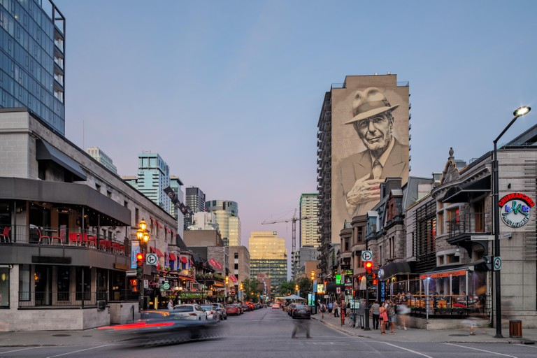 Illuminated Leonard Cohen mural on Crescent Street viewed from De Maisonneuve boulevard by El Mac / Gene Pendon, Downtown Montreal, Quebec, Canada