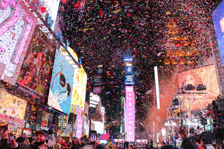 Millions of people gather at Times Square in New York City to watch the ball drop