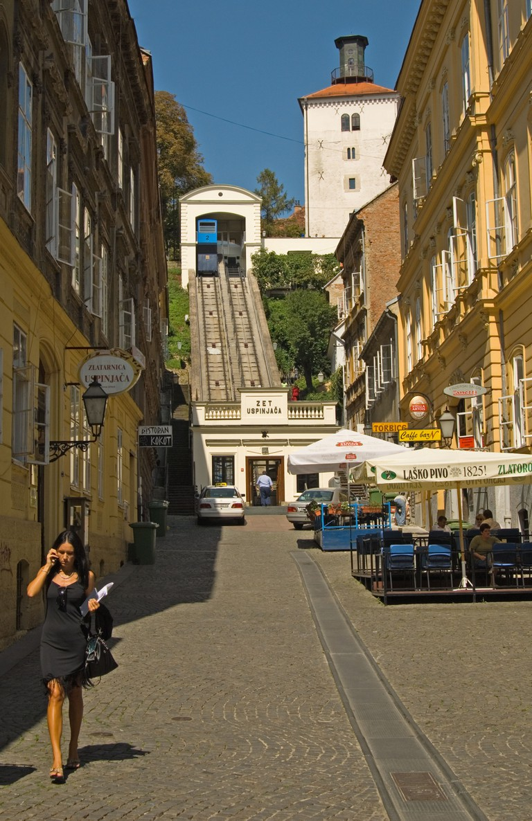 Zagreb, Croatia. Funicular Railway in Tomiceva street going up to the old town. Woman with mobile phone