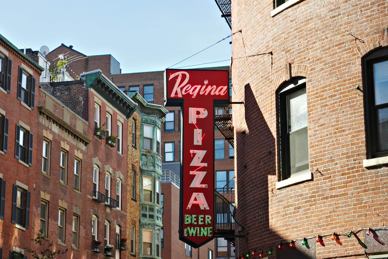 MASSACHUSETTS Boston Regina Pizza neon sign on brick building North End neighborhood