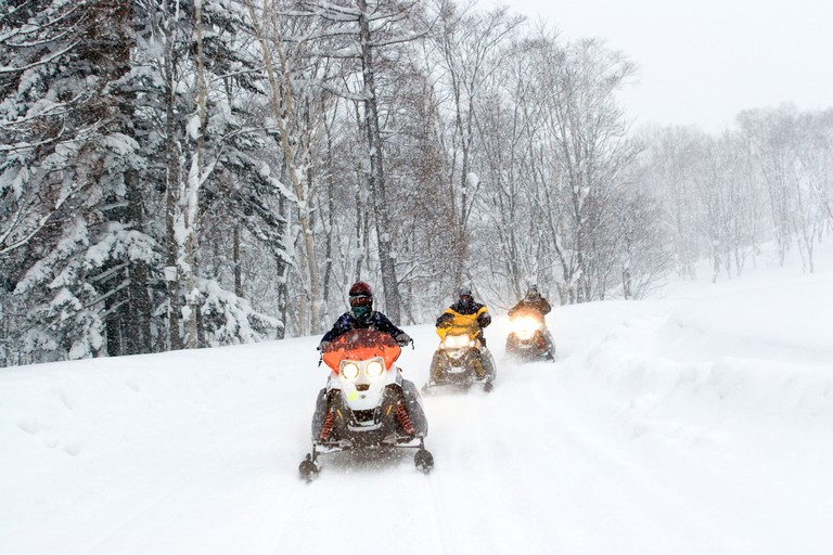 Snow mobiling on the trails around Hanazono in Niseko