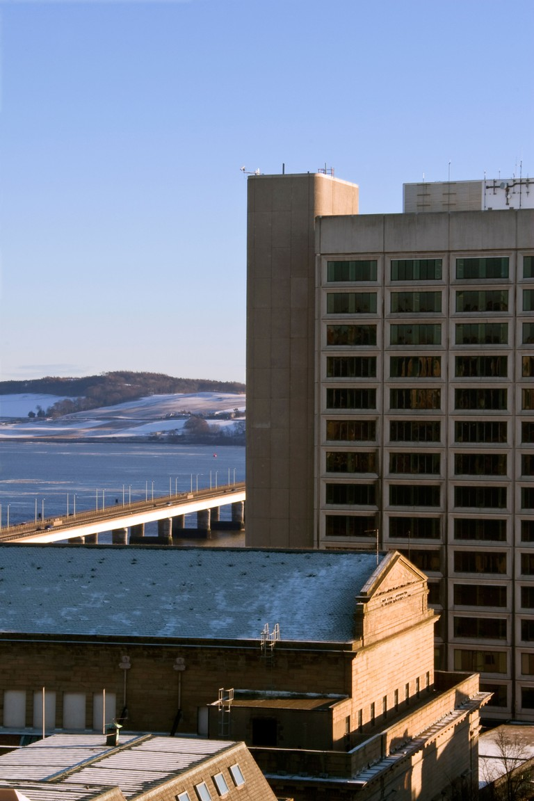 Winter portrait of the Tayside House Office building and the Tay road bridge in central Dundee