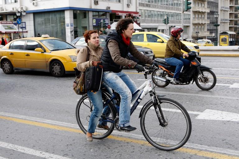 Women cycles among vehicles