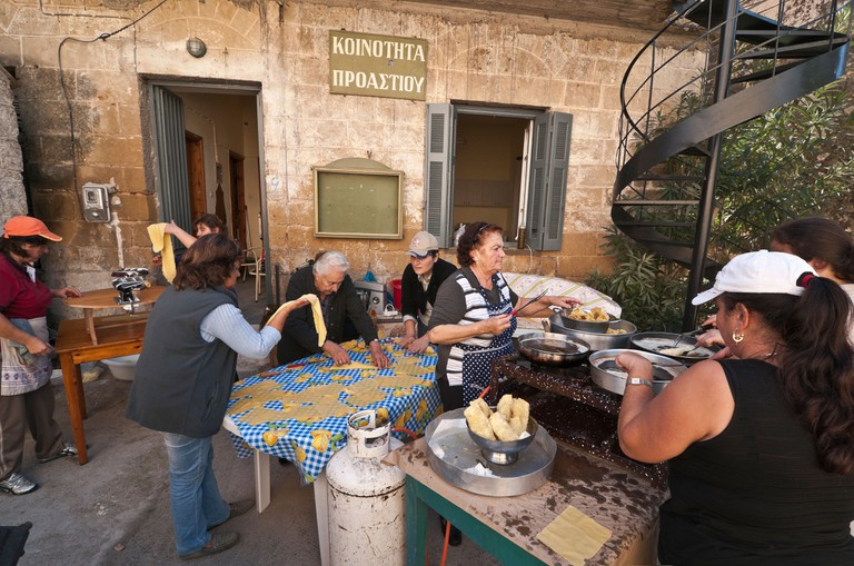 Women in the village of Proastio making diples, fried, sweet pastries, for a festival  Outer Mani, Peloponnese, Greece