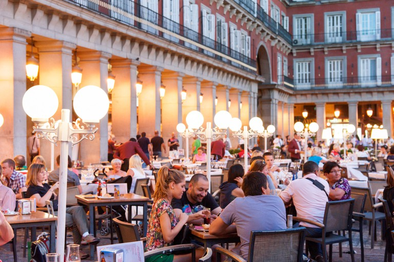Early evening dining at one of the restaurants in the Plaza Mayor, Madrid, Spain