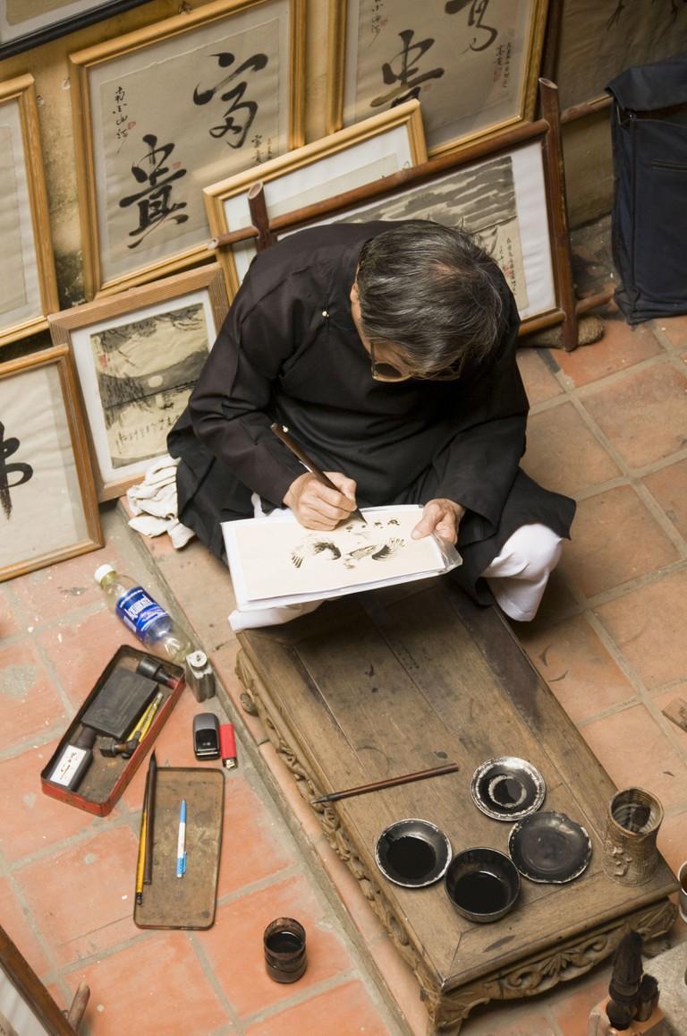 Artist at work in Hanoi Vietnam