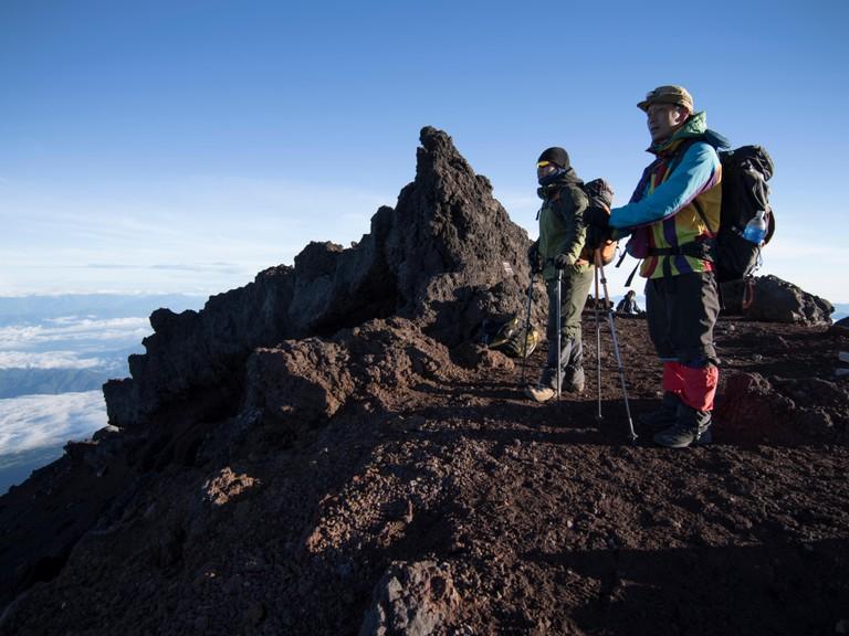 Hikers climbing Mt. Fuji