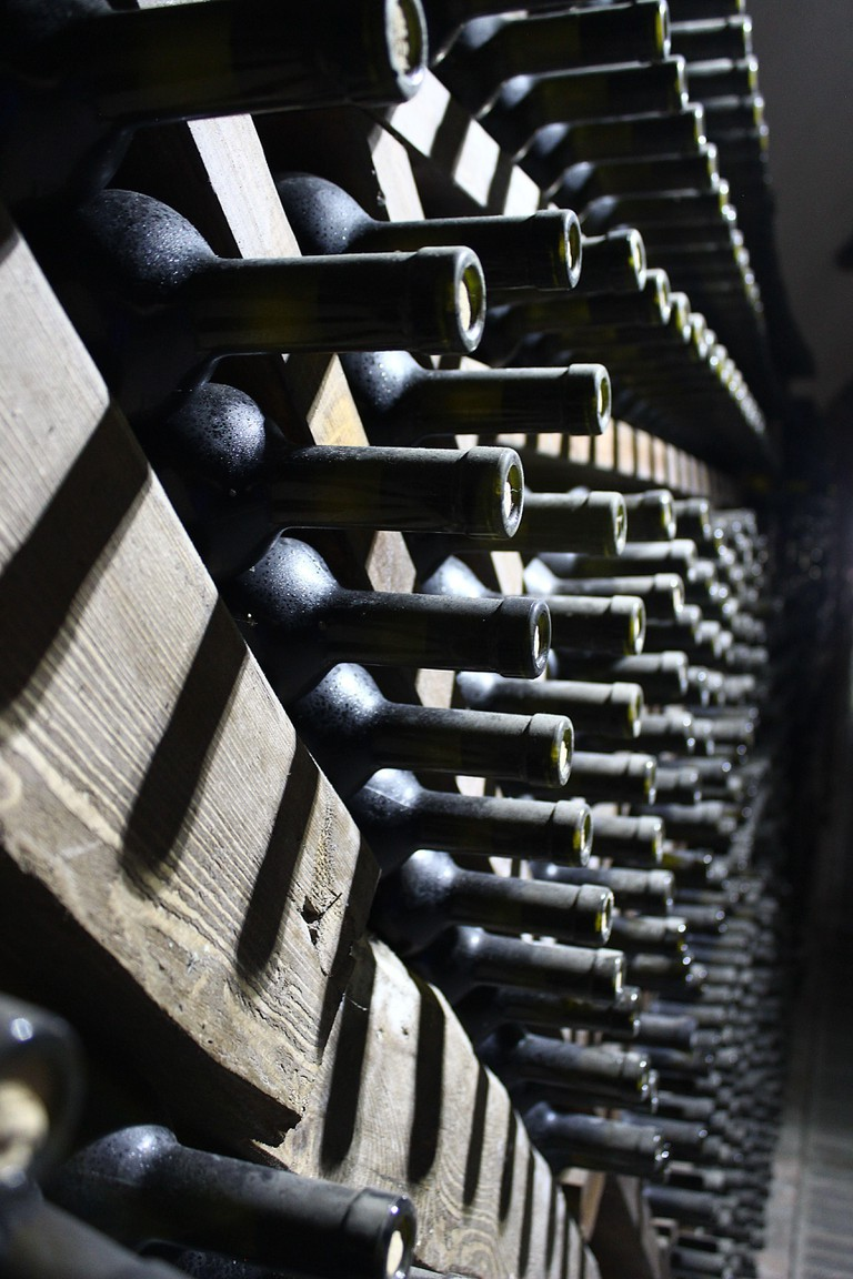 Winery Khareba with wine tunnels and stacked wine bottles in Kakheti region of Georgia