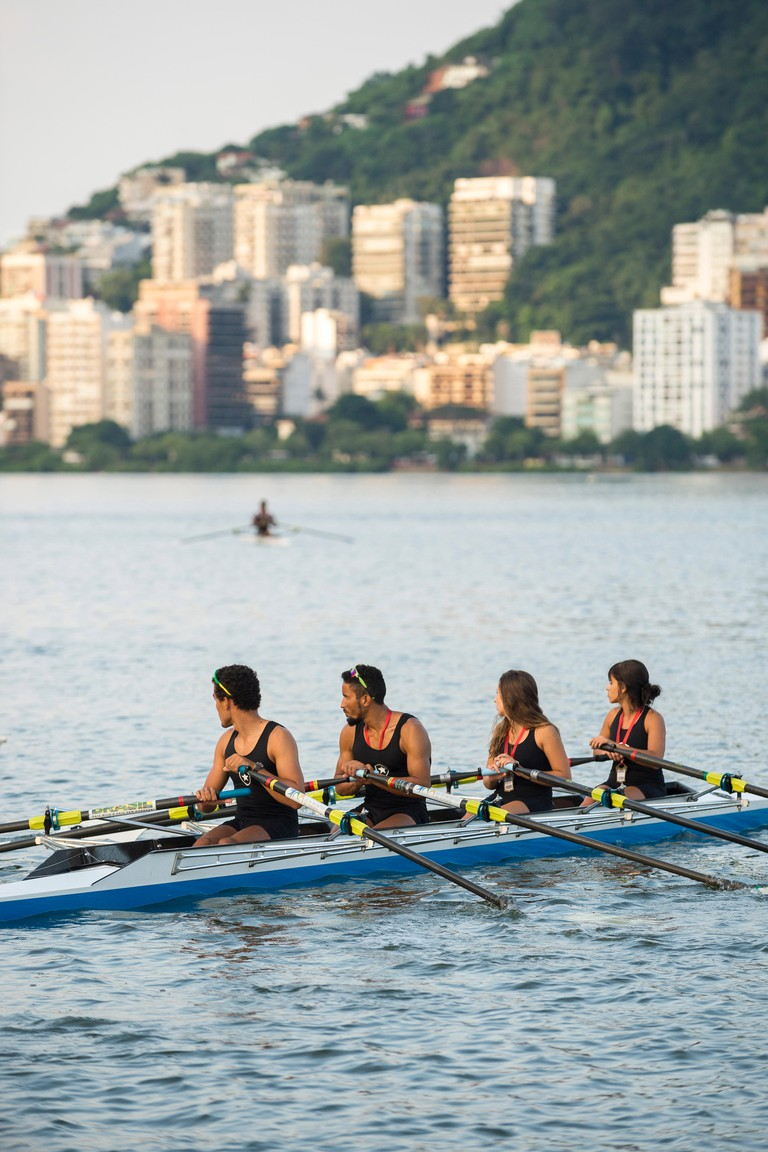 RIO DE JANEIRO - APRIL 2, 2016: A quadruple scull boat (with four rowers) prepares to compete in a race at Lagoa.