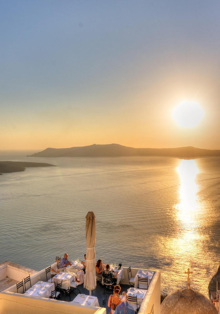 Greece, Cyclades, Santorini island, Fira, restaurant on the caldera