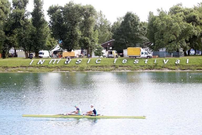 Zagreb, Croatia. 20th June, 2016. : Ambience and atmosphere on the first day of 11th INmusic festival located on the lake Jarun in Zagreb, Croatia. Sign of Inmusic festival viewed from other side of the lake. Credit:  PhotoJa/Alamy Live News