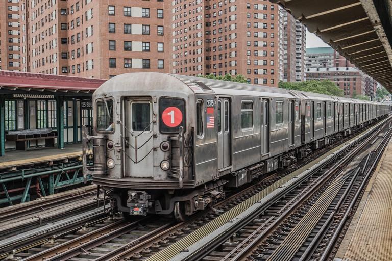 Subway Train traveling through New York City.