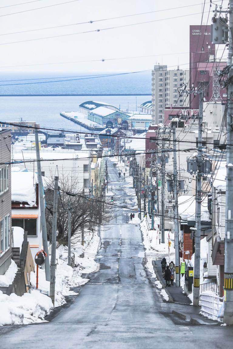 View of snowcapped Funamizaka Street in Otaru, Hokkaido, Japan.